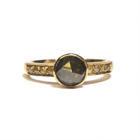 Yellow gold ring with rose cut black diamond and champagne diamonds